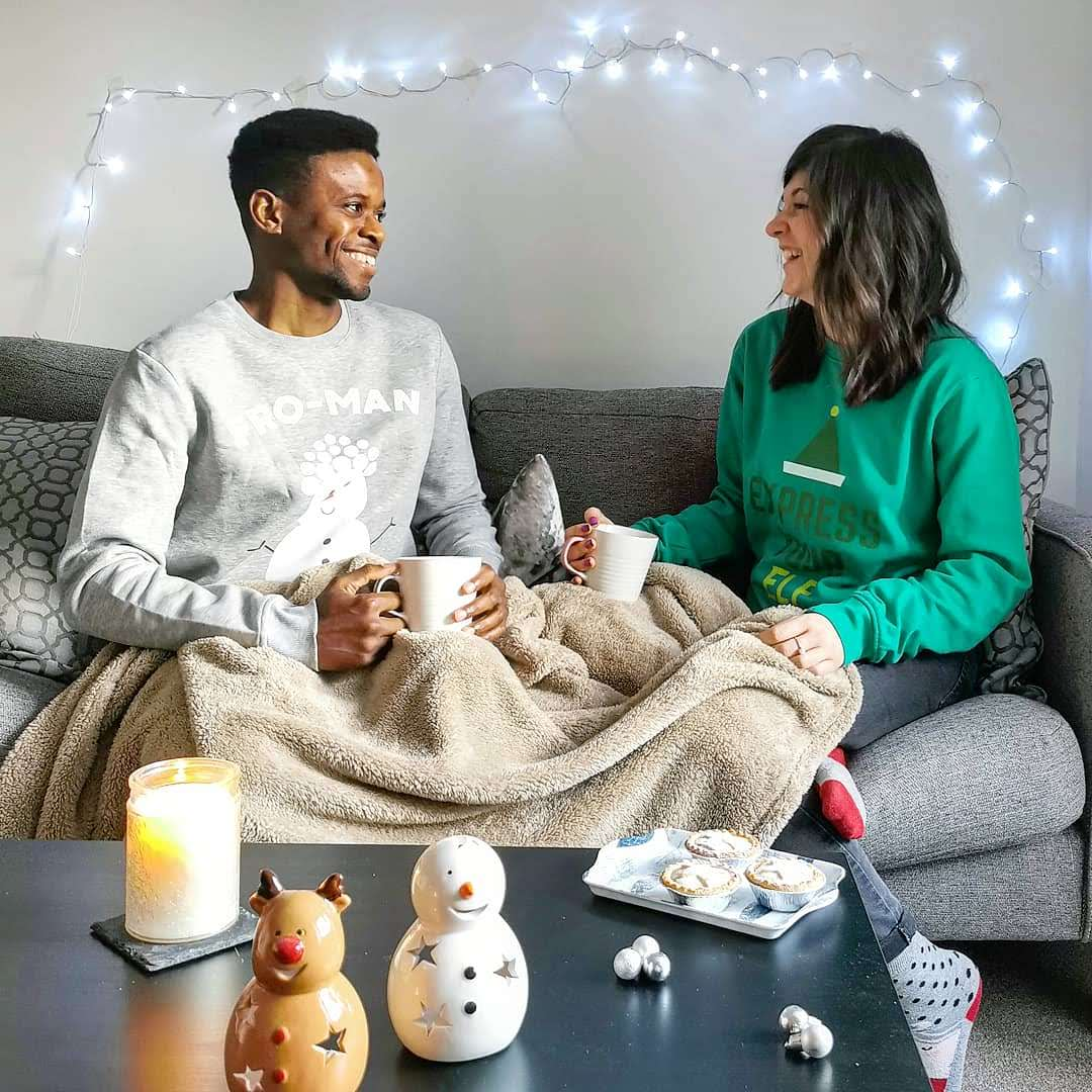 Christmas 2019 - couple wearing Christmas jumper from IWOOT