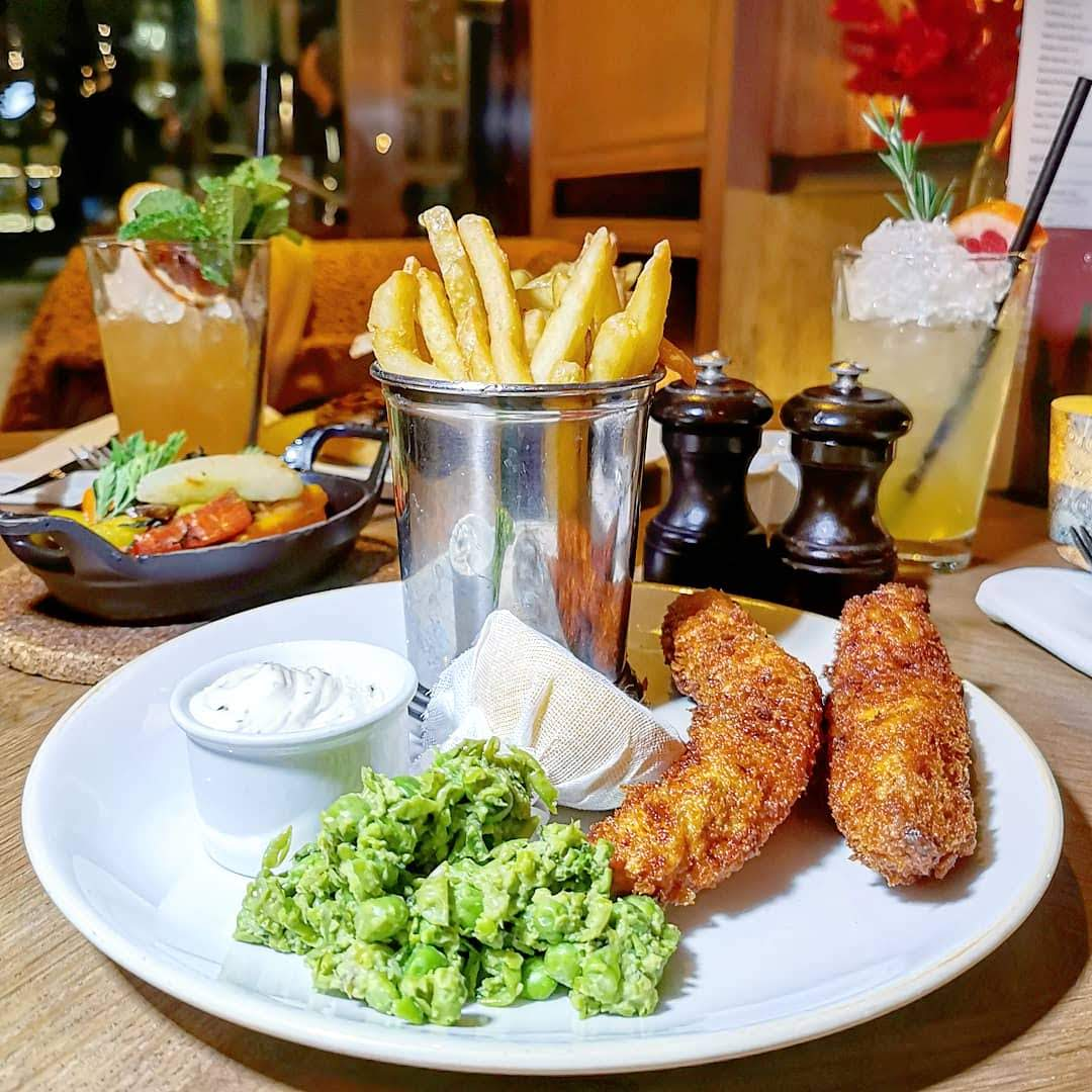 Percy & Founders, fish goujons with mushy peas and chips