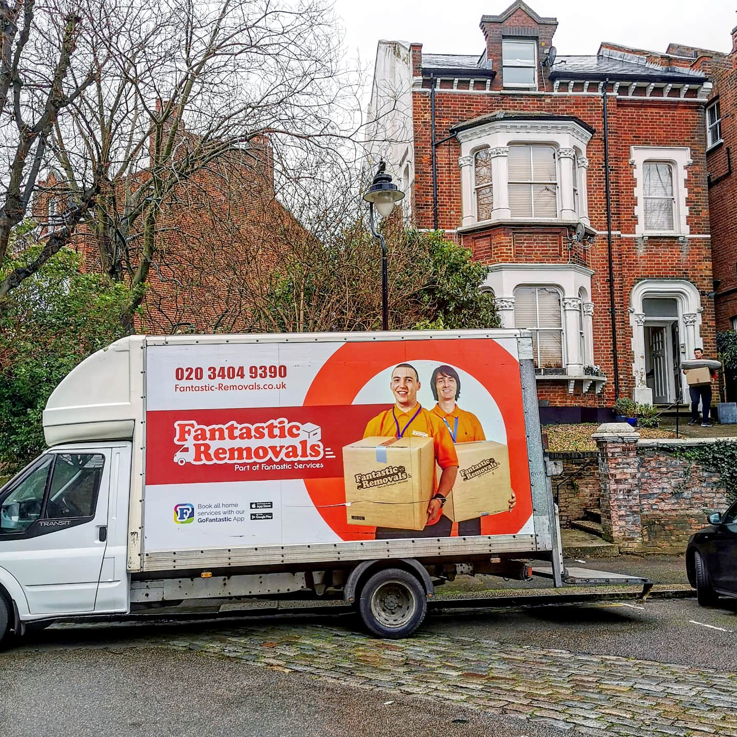 Fangtastic Services Removals Van infront of house