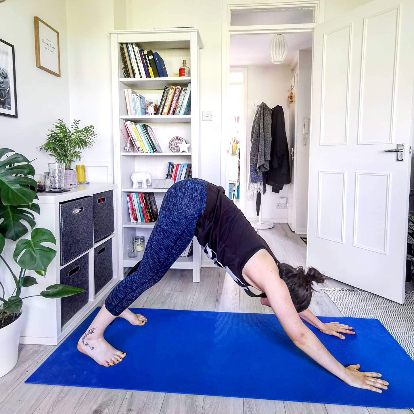 Female doing yoga in small flat