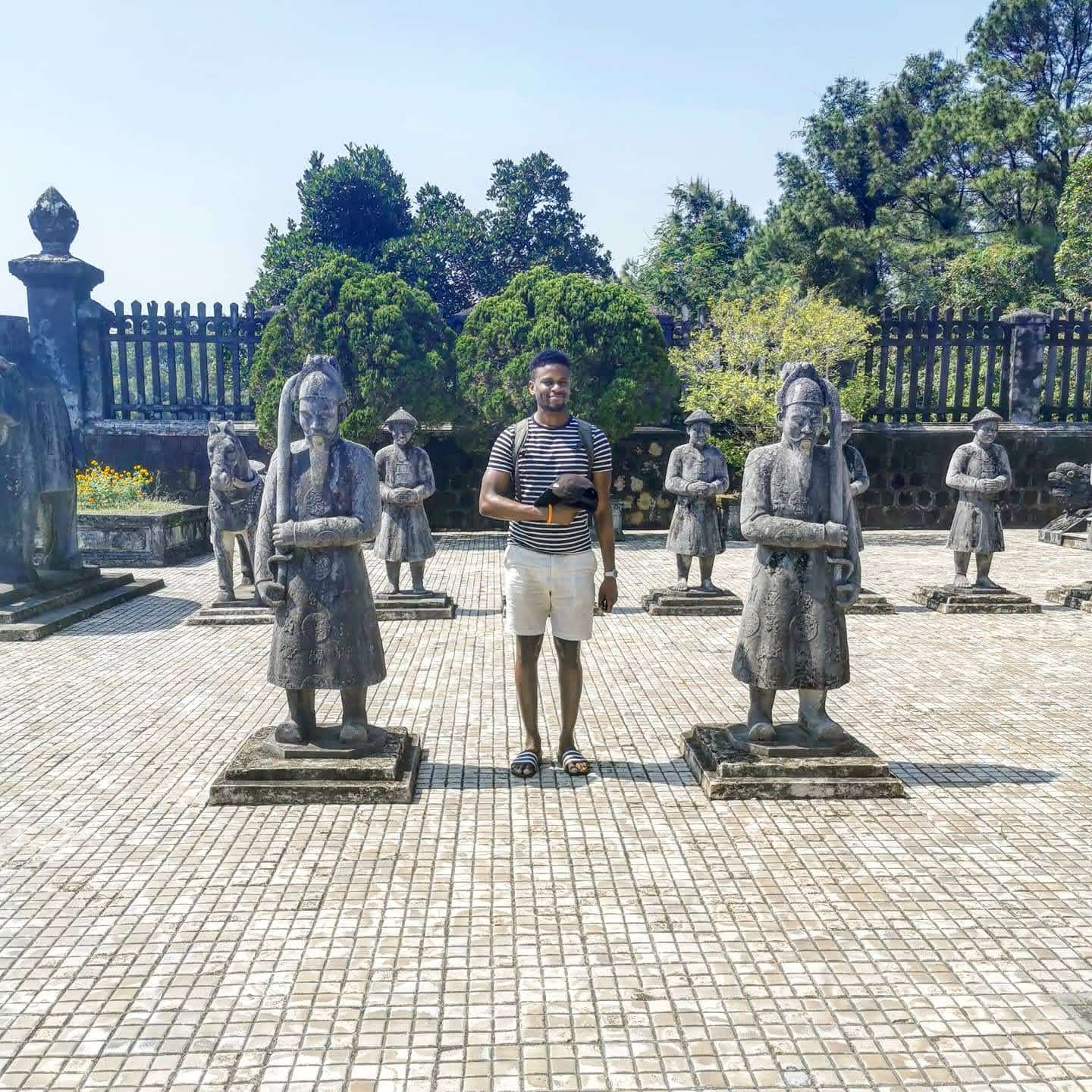 Stood between statues by Khai Dinh Tomb