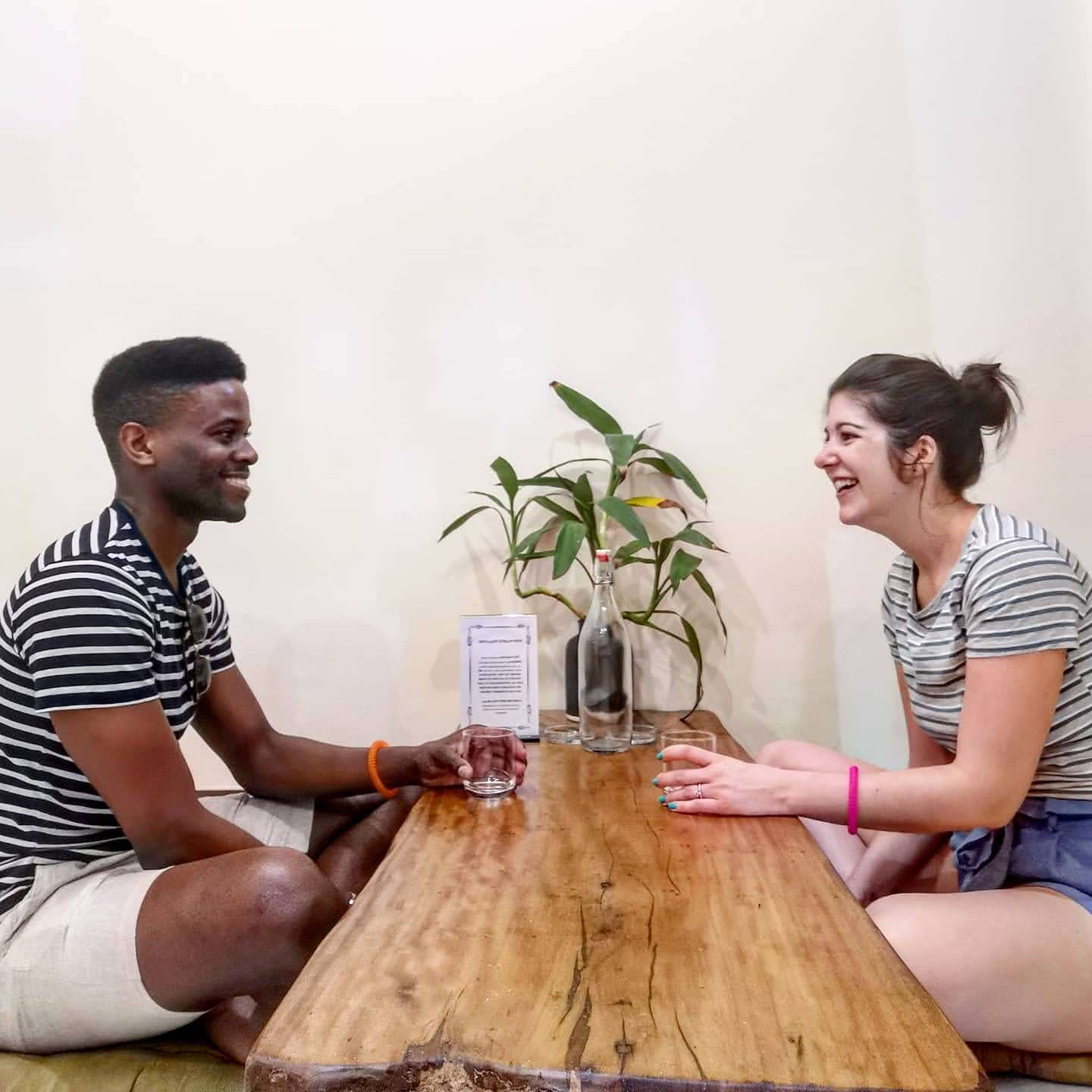 Couple sat at table in bedroom at Purple Hue Bnb