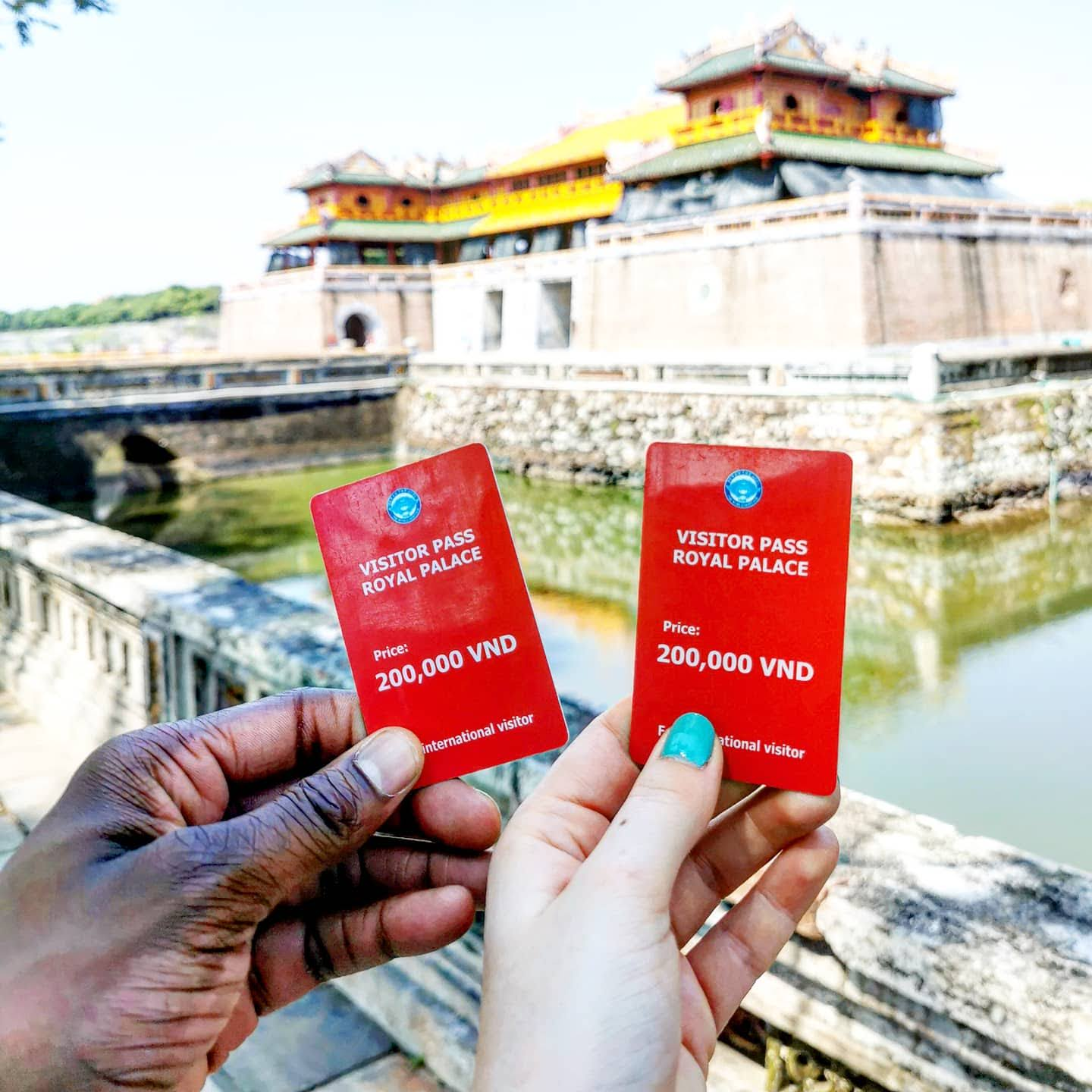 Holding tickets to Imperial City Tombs in Hue