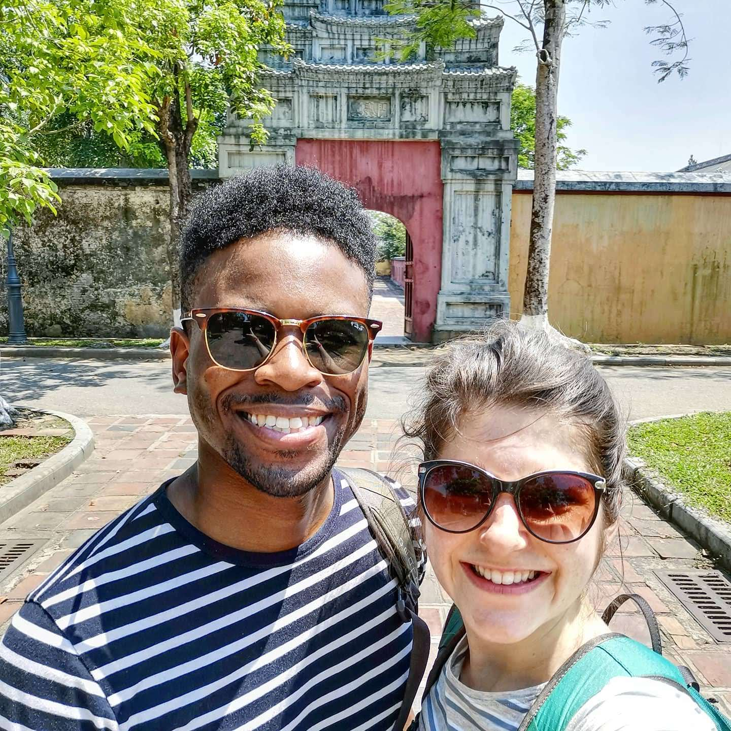 Couple in front of gate in Imperial City of Hue