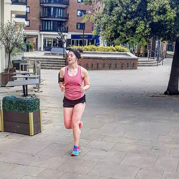 female running through built-up area with modibodi shorts for incontinence when running